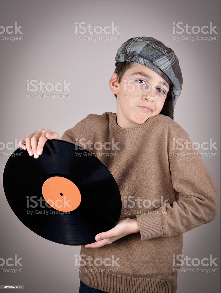 Young boy holding a vinyl record stock photo