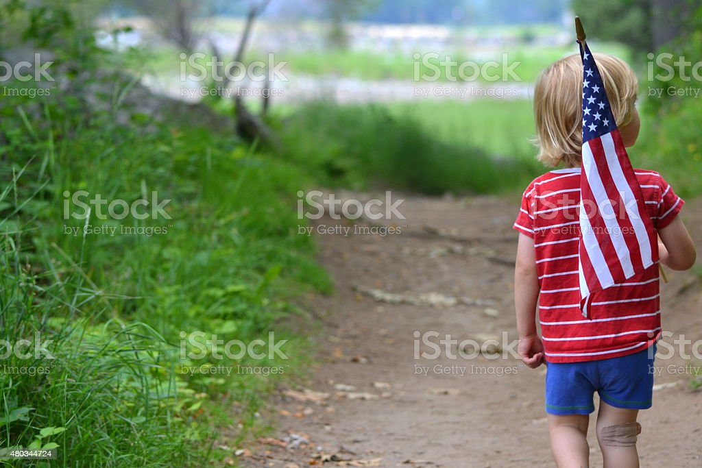 Young boy holding American Flag stock photo