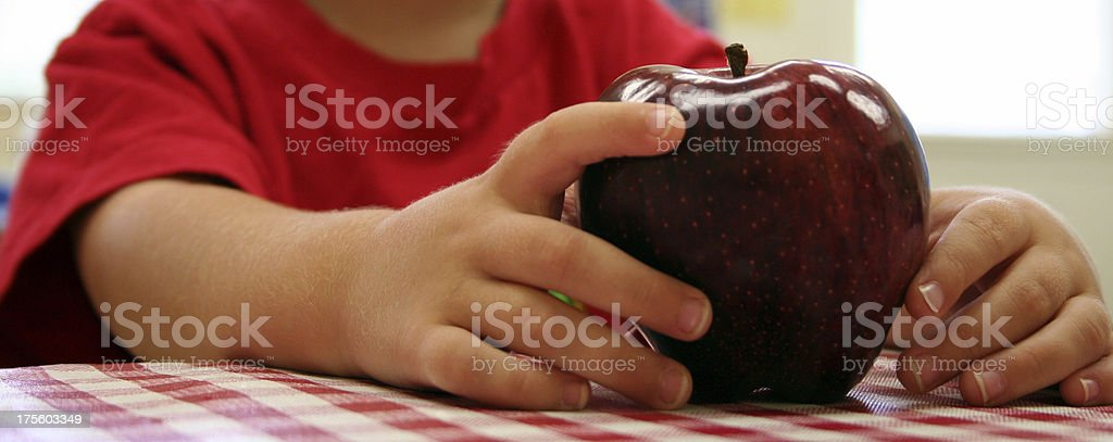 Young Boy Holding An Apple Learning About Nutrition royalty-free stock photo