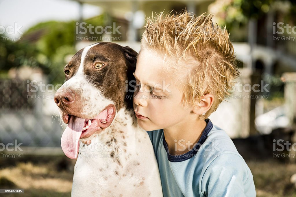 Young boy holding his Dog royalty-free stock photo