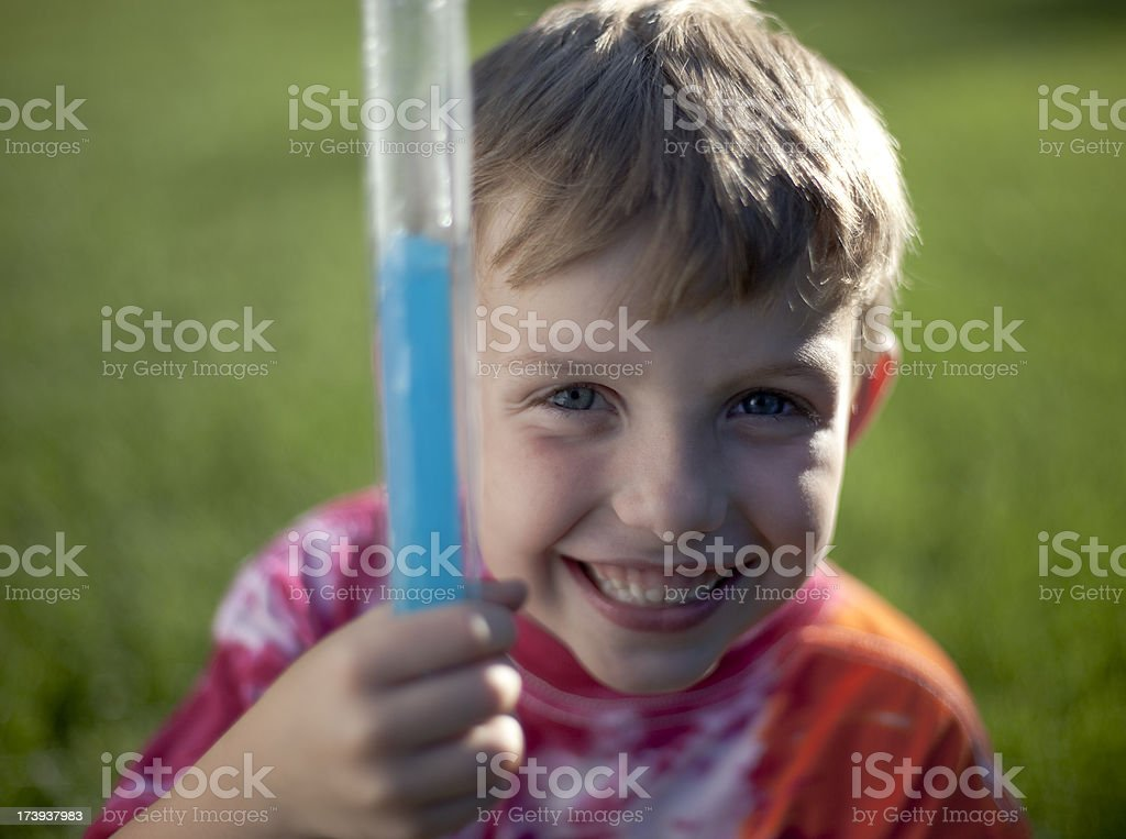 Young boy holding popsicle frozen treat royalty-free stock photo