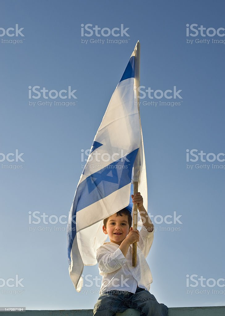 young boy holding the Israeli flag stock photo