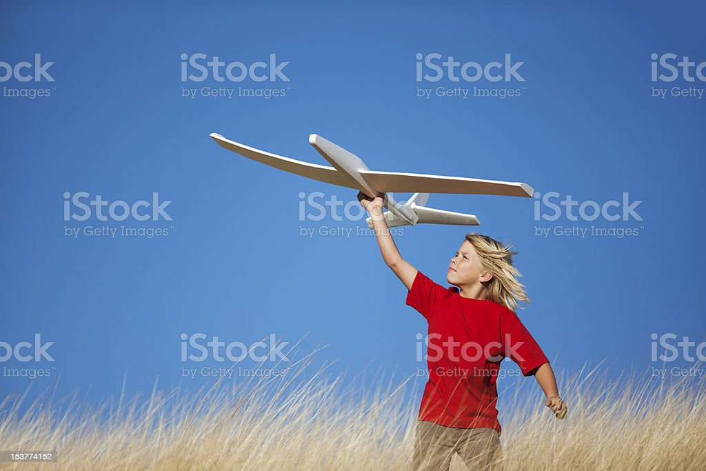 Young Boy Holding Toy Glider Airplane stock photo