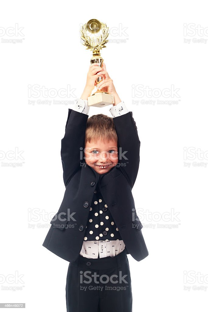 Young boy holding trophy isolated on white stock photo