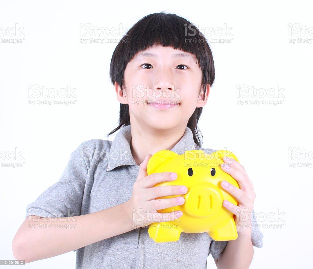 Young boy holding yellow piggy bank Lizenzfreies stock-foto