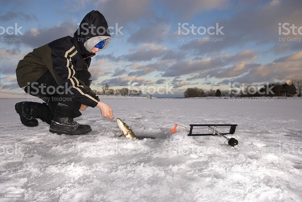 Young Boy Ice Fishing stock photo