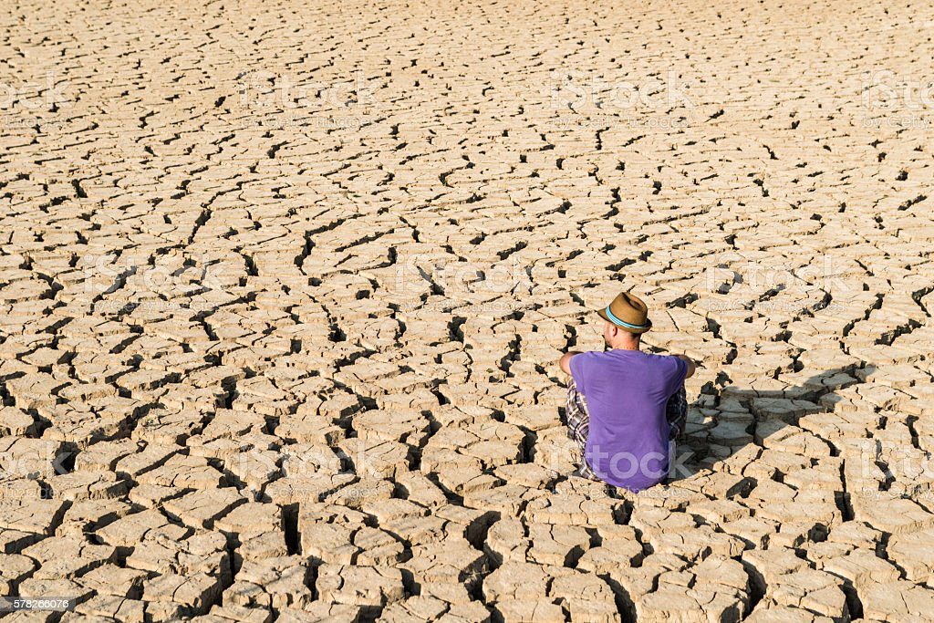 young boy in a desert stock photo