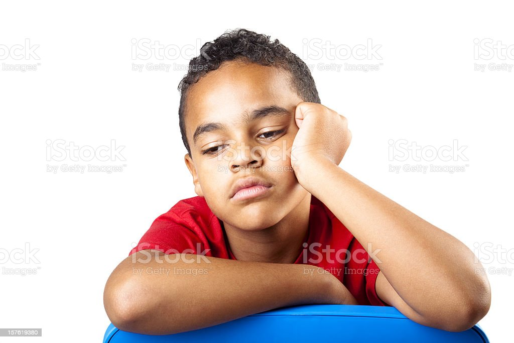 A young boy in a red shirt is bored and tired  royalty-free stock photo