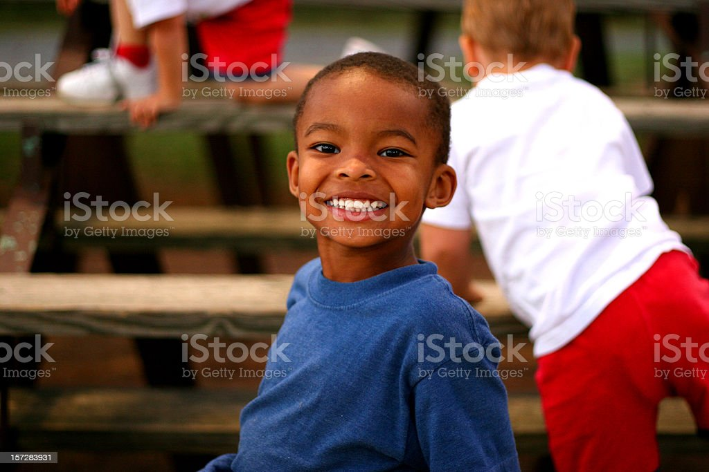 Young Boy in Bleachers 1 royalty-free stock photo