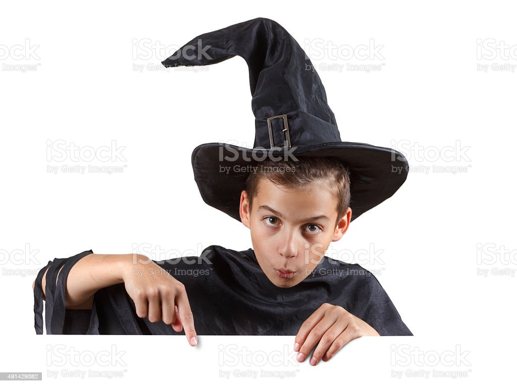 Young boy in carnival costume wizard. Isolated on white stock photo