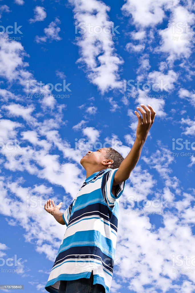 Young Boy In Clouds / Inspirational royalty-free stock photo