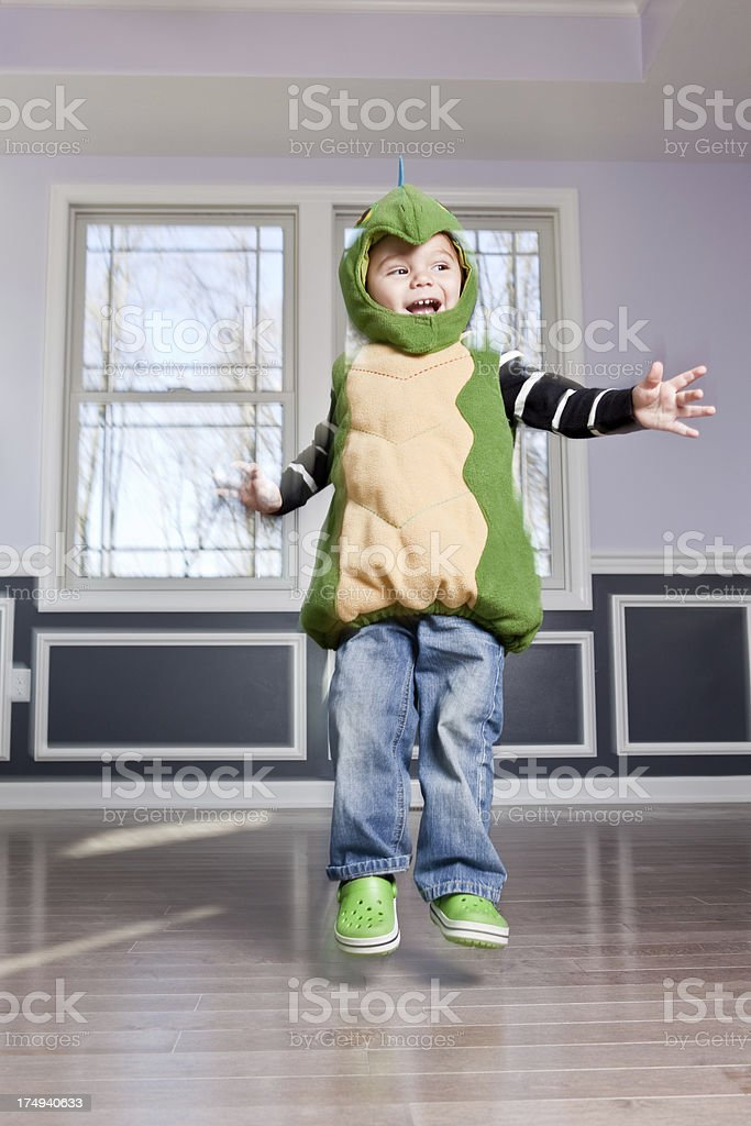 Young Boy in Costume Jumping stock photo
