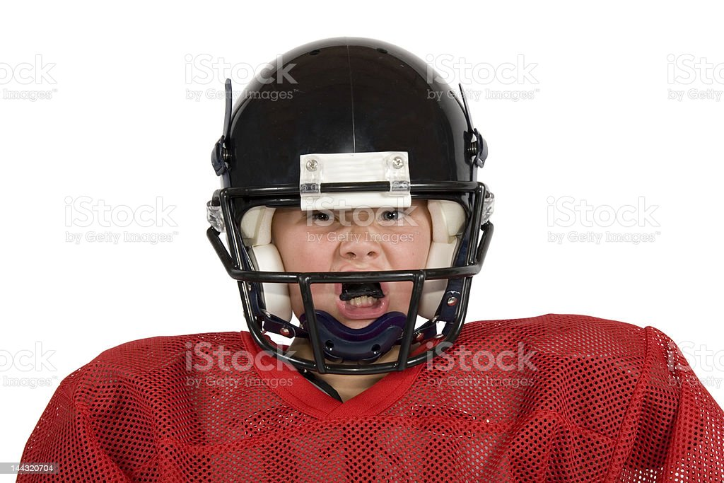 Young boy in football gear including black helmet royalty-free stock photo