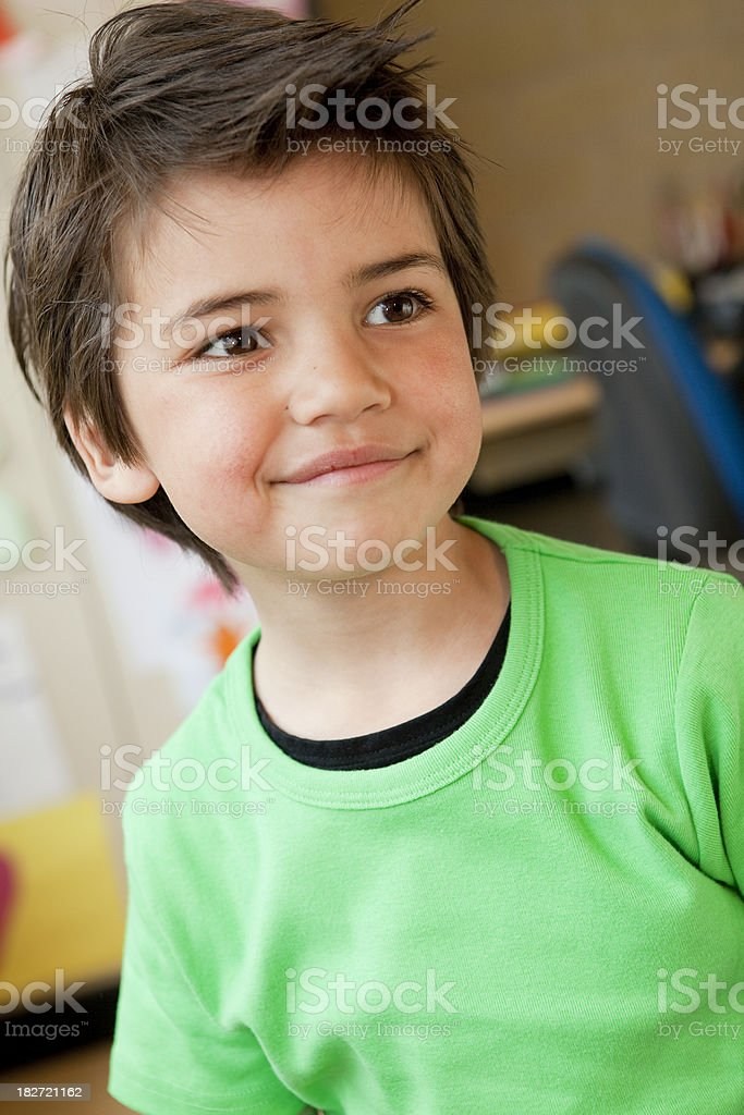 Young boy in his classroom royalty-free stock photo