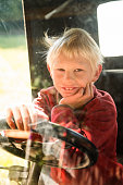 young boy in large model car