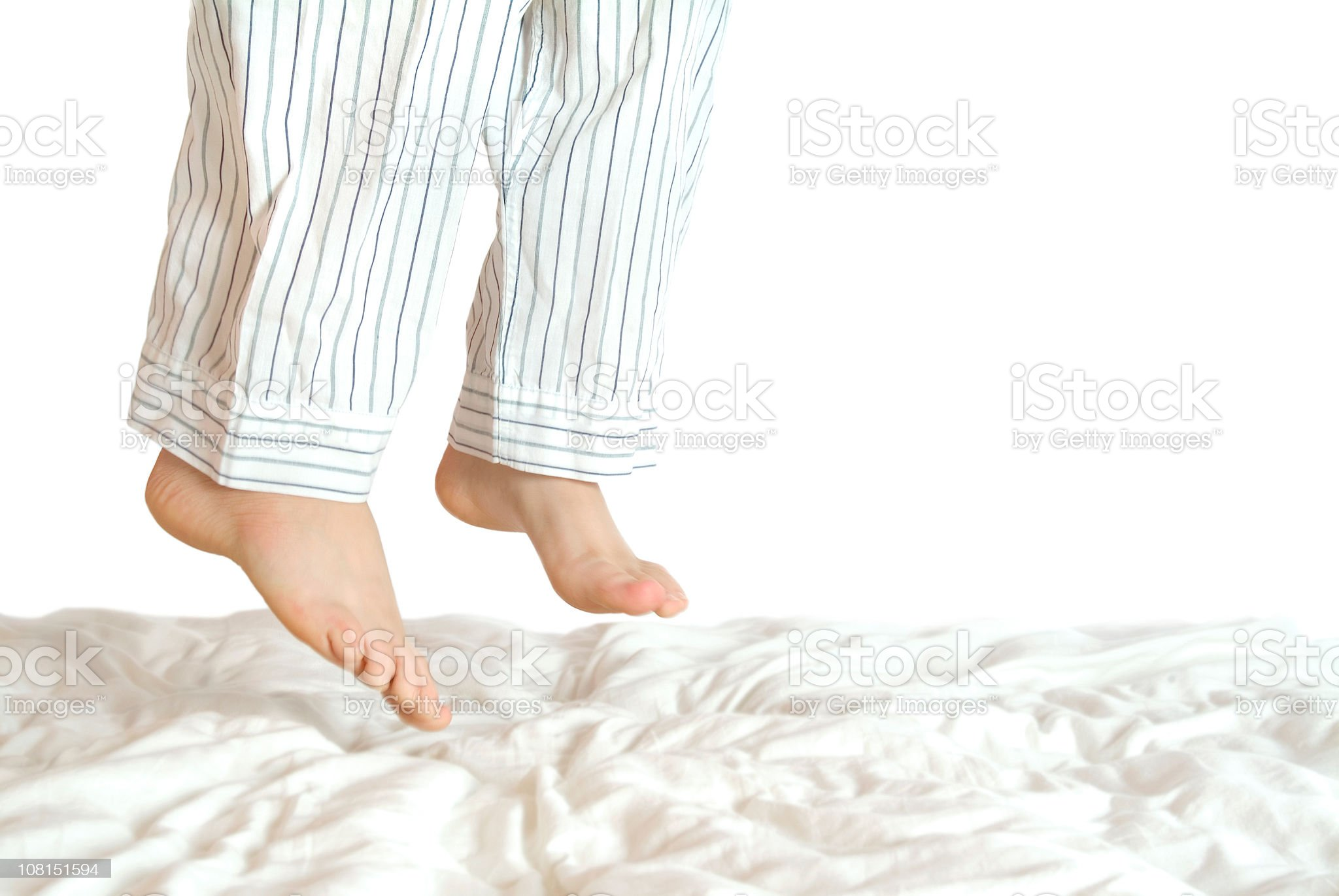 Young Boy in Pajamas Jumping on the Bed royalty-free stock photo