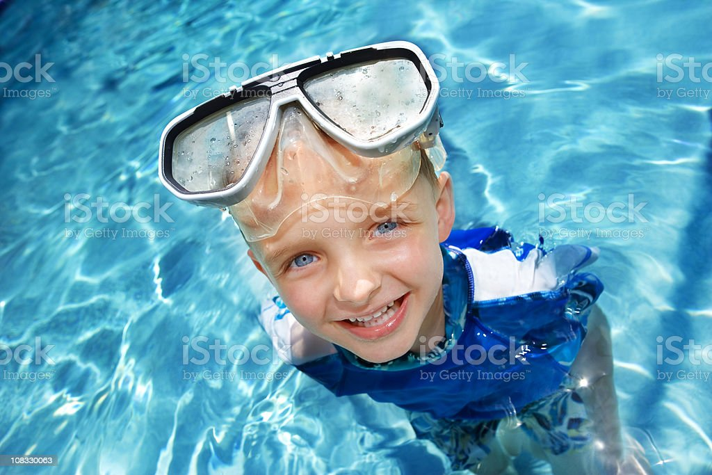 Young boy in swimming pool royalty-free stock photo