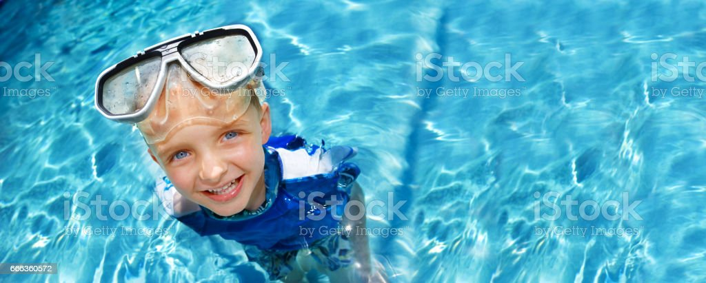 Young boy in swimming pool stock photo