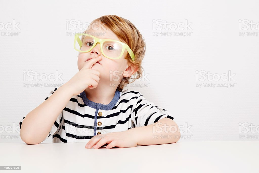 Young boy in yellow specs stock photo