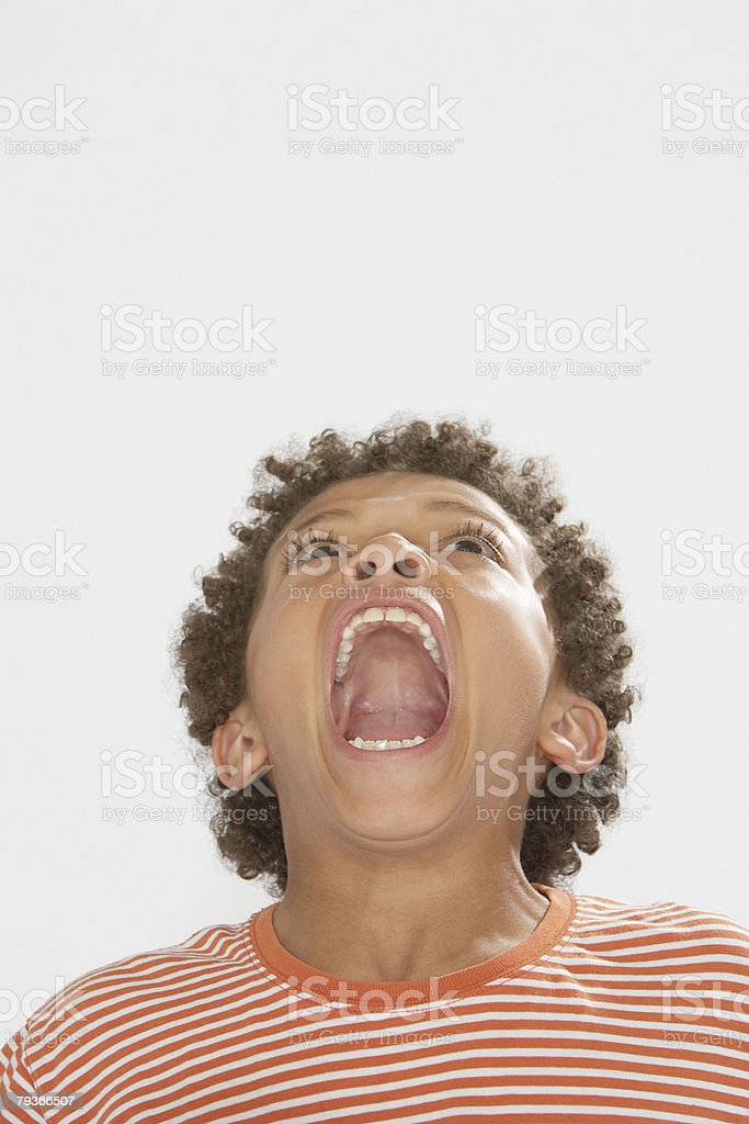 Young boy indoors shouting royalty-free stock photo