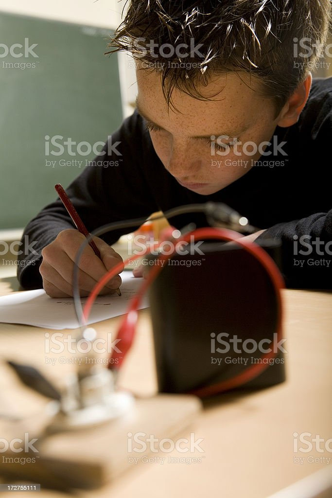 Young boy is learning for technician royalty-free stock photo