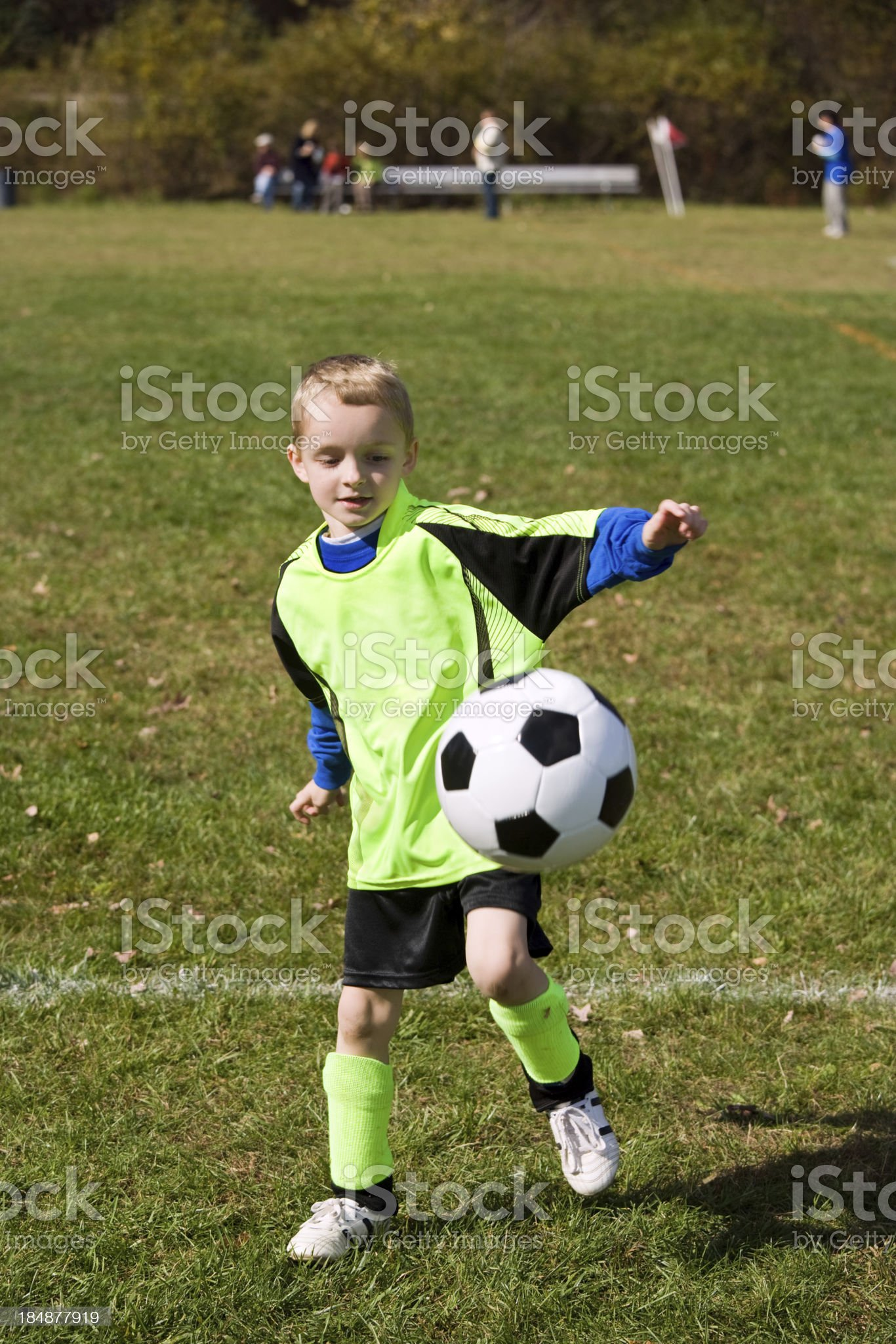 young boy juggling soccer ball royalty-free stock photo