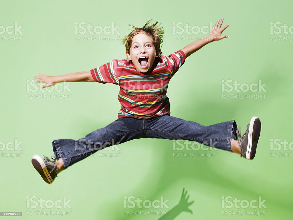 Young boy jumping in mid-air stock photo
