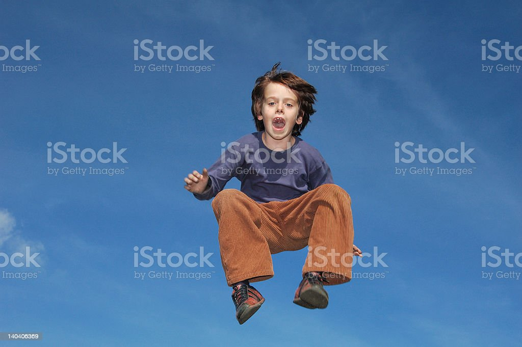 Young Boy Jumping In The Sky stock photo