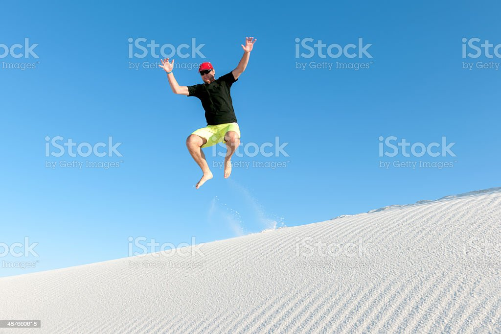 Young boy jumping in the White Sands National Monument ,USA stock photo