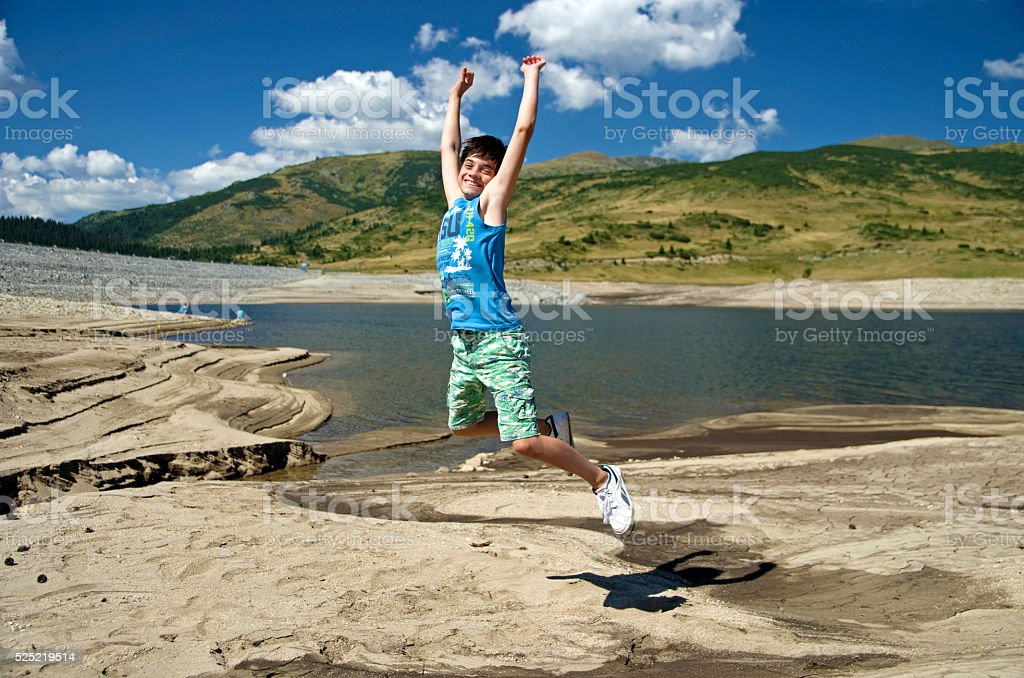 Young boy jumping royalty-free stock photo