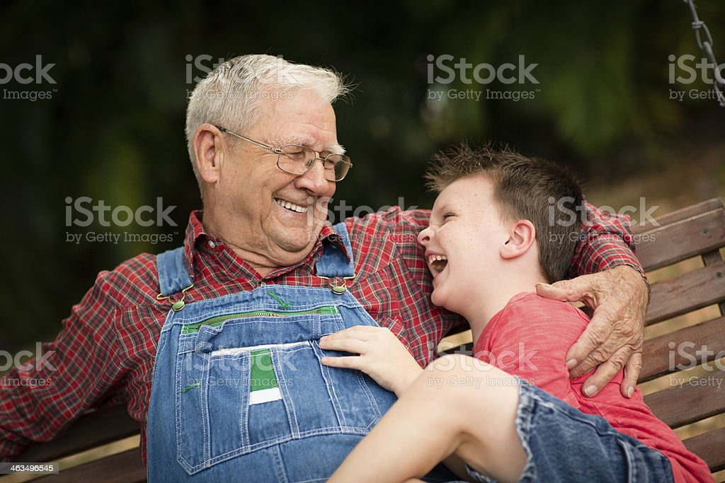Young Boy Laughing With His Great Grandfather royalty-free stock photo