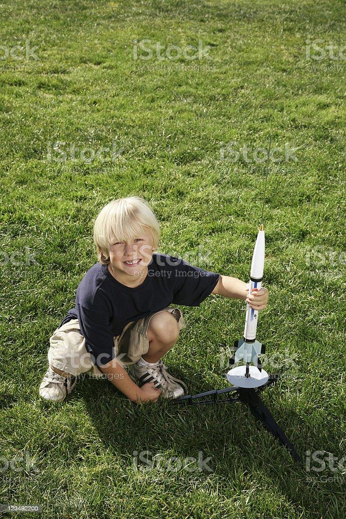 young boy launching a rocket ship royalty-free stock photo