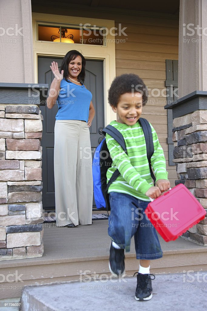 Young boy leaves for school stock photo