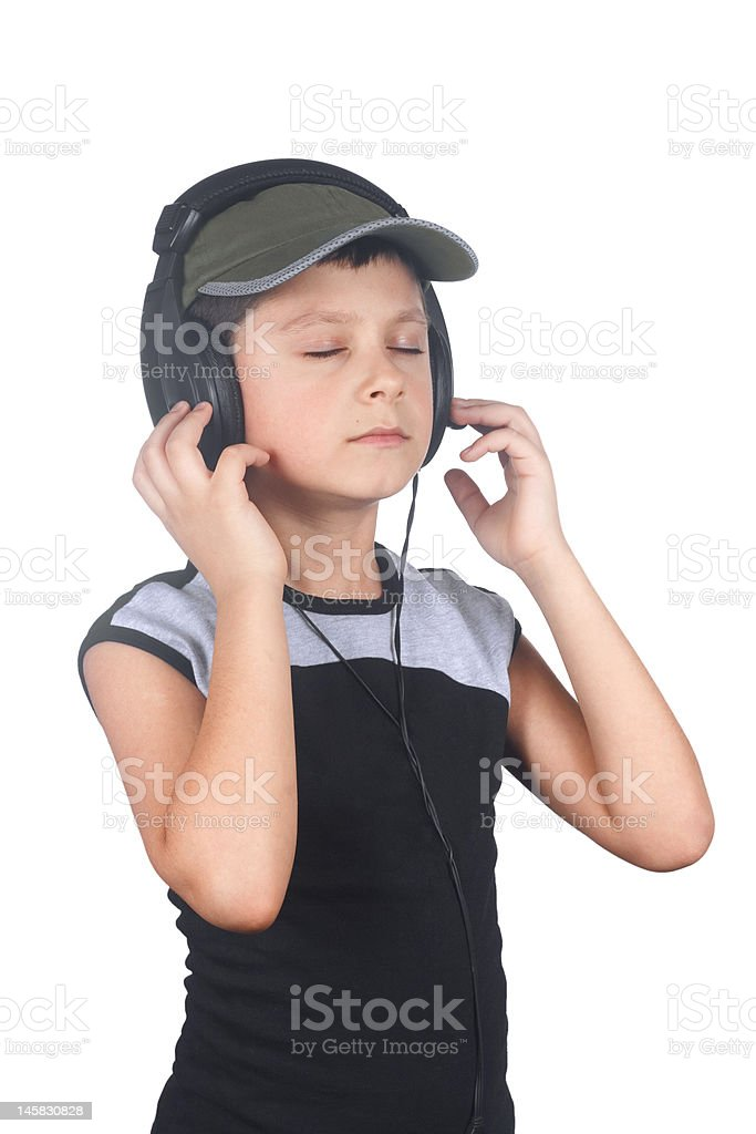 Young boy listening to music royalty-free stock photo