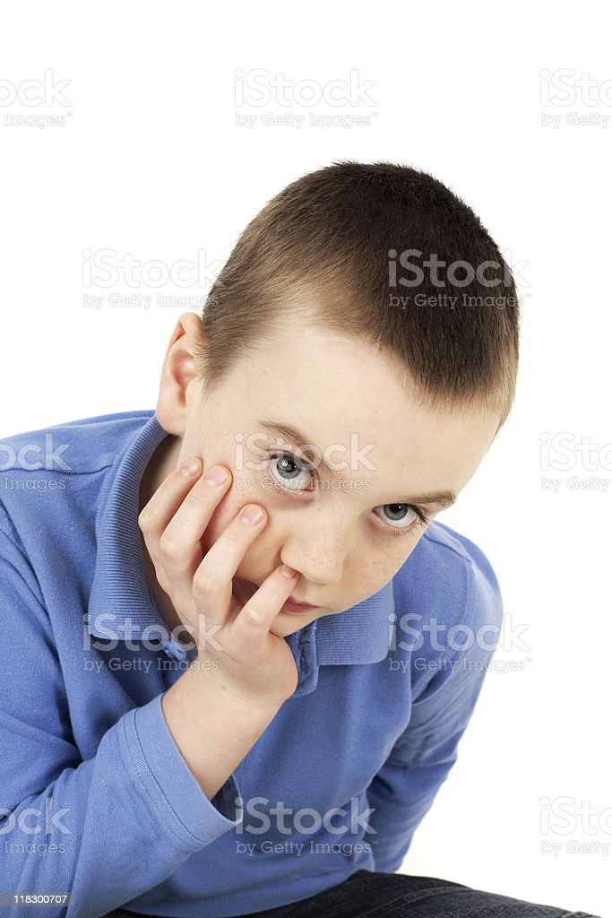 Young boy looking at camera stock photo