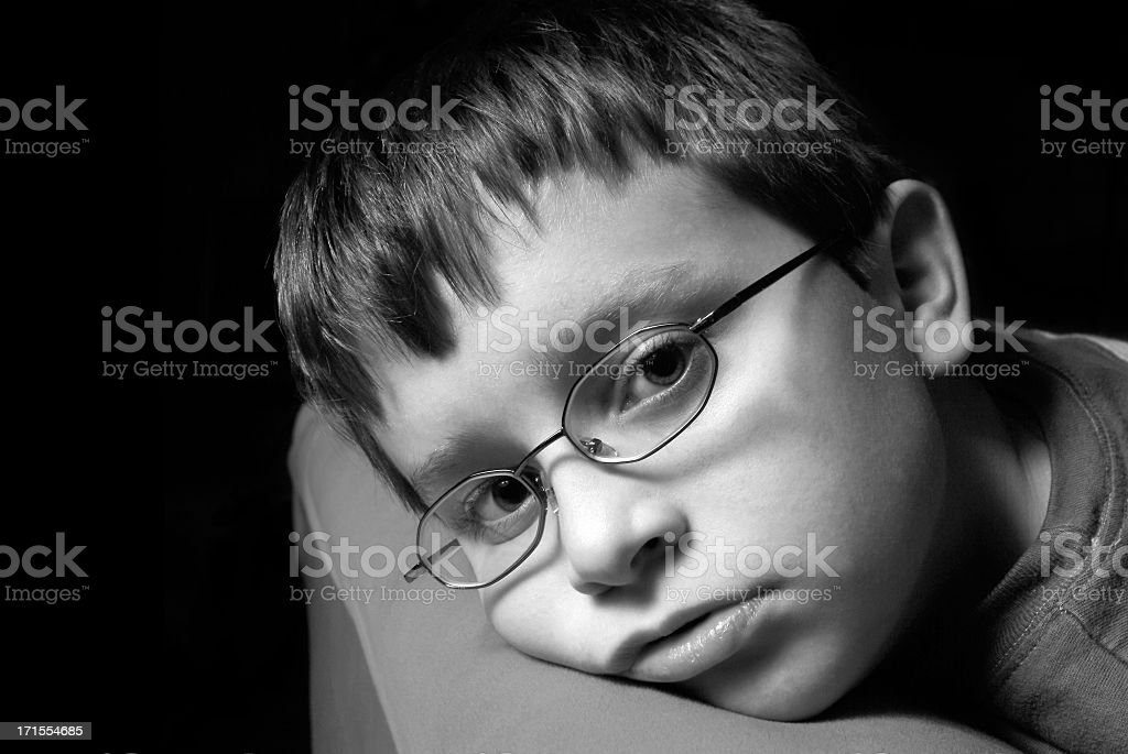 Young Boy Looking of Defeat or Depression or Boredom royalty-free stock photo