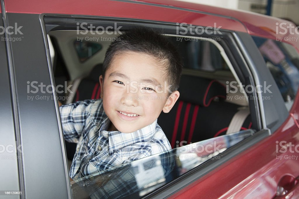 Young Boy Looking Out a Car Window royalty-free stock photo