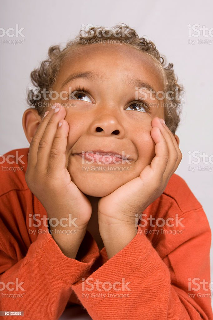 Young boy looking up stock photo