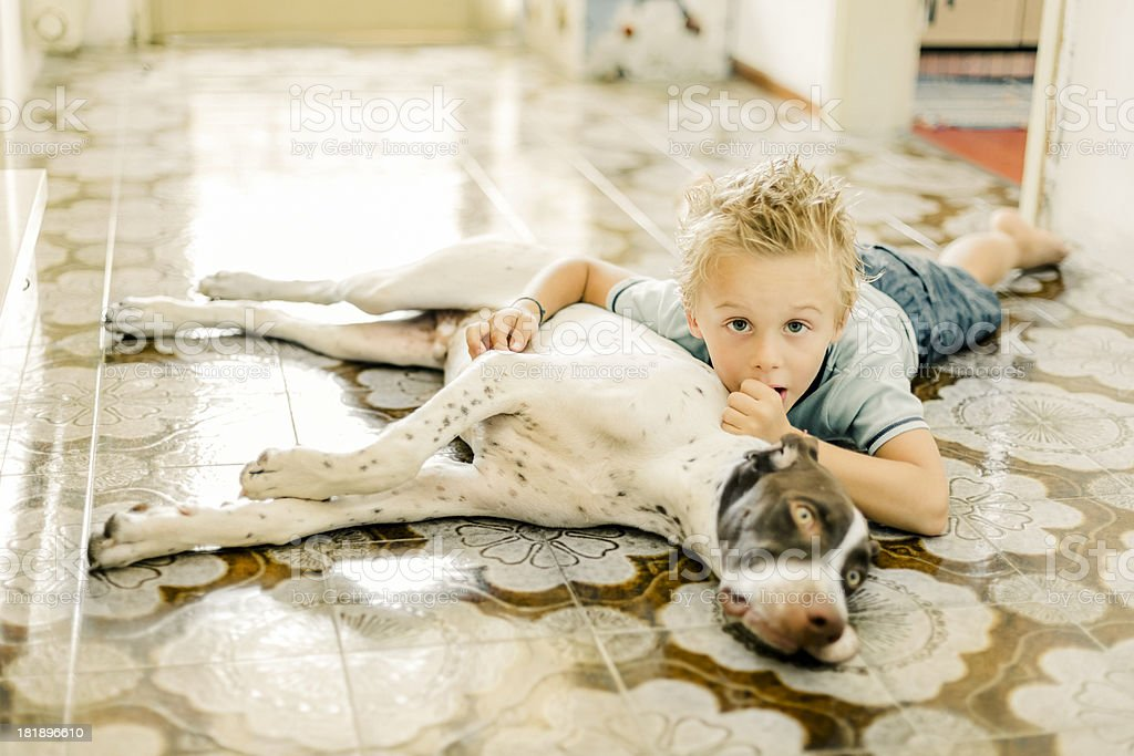 Young boy lying on the floor with his Dog royalty-free stock photo
