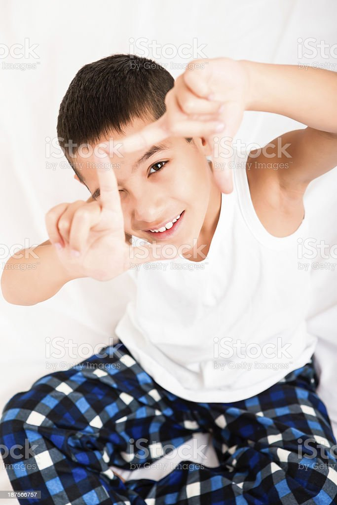 Young boy making a frame with her hands royalty-free stock photo