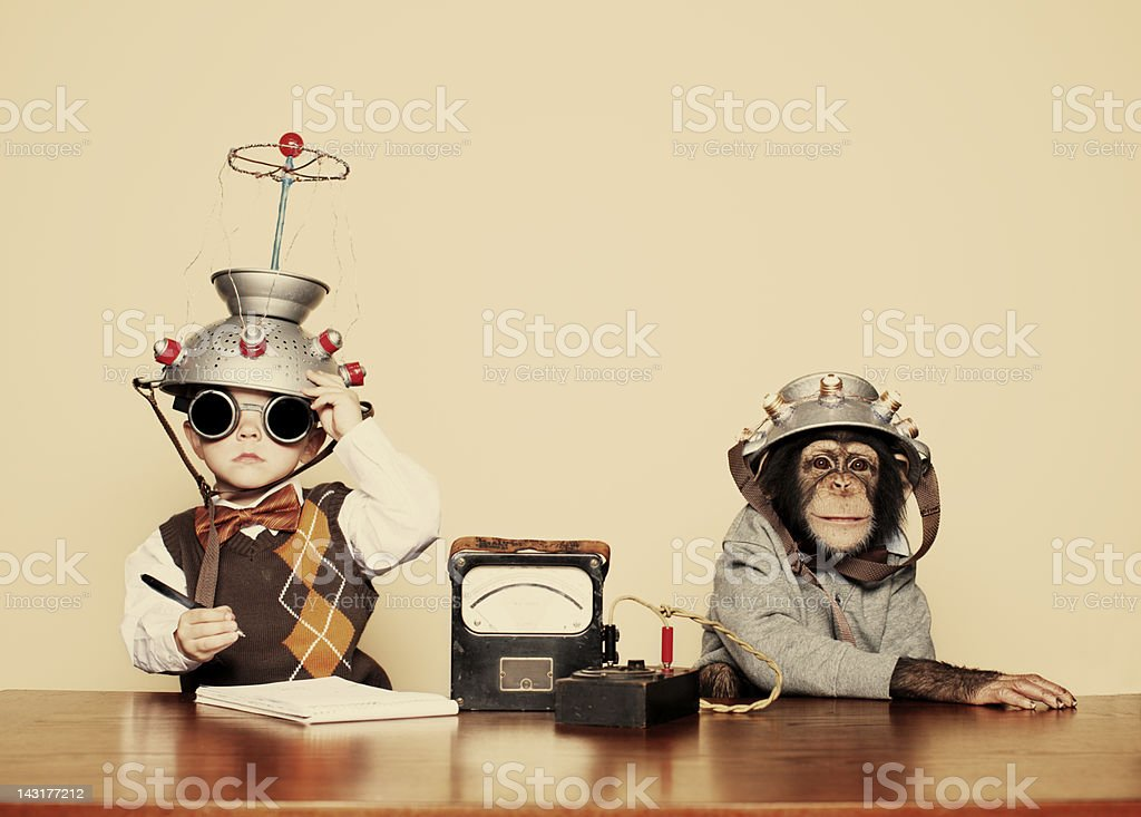 Young Boy Nerd Reads Chimpanzee Mind stock photo
