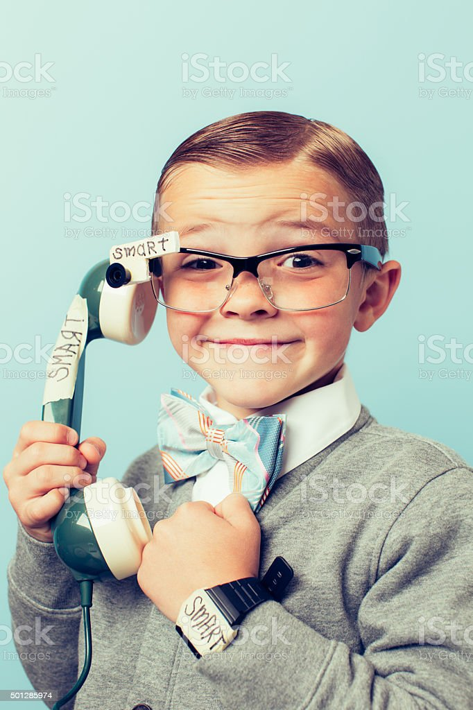 Young Boy Nerd Using Smart Phone and Glasses stock photo