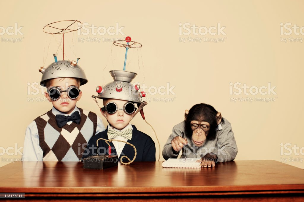 Young Boy Nerds Do Science with Chimpanzee stock photo