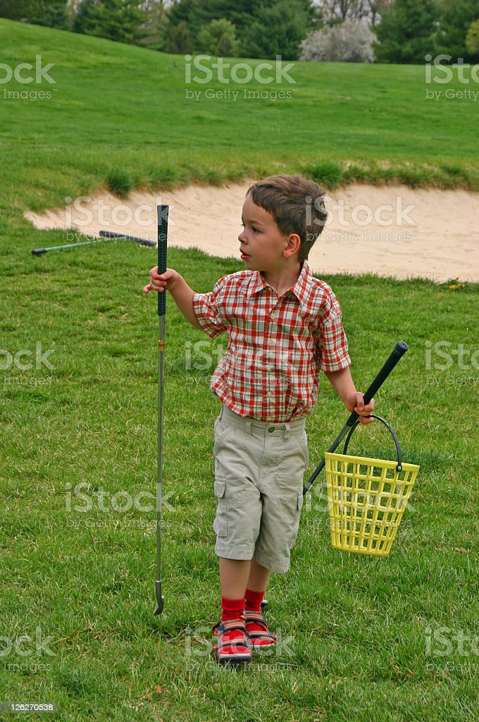 Young boy on a golf course royalty-free stock photo
