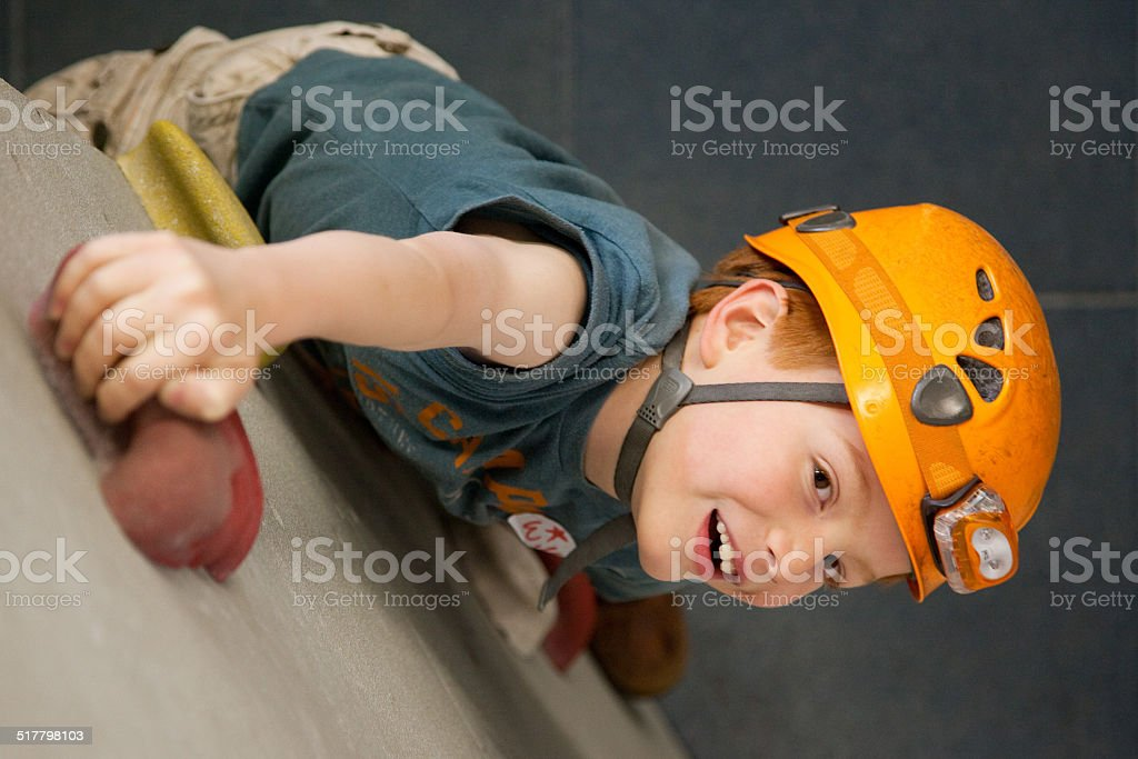 Young Boy on a Rock Climbing Wall stock photo