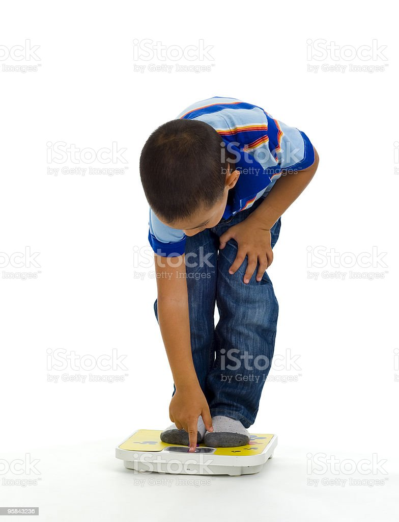 young boy on scale royalty-free stock photo