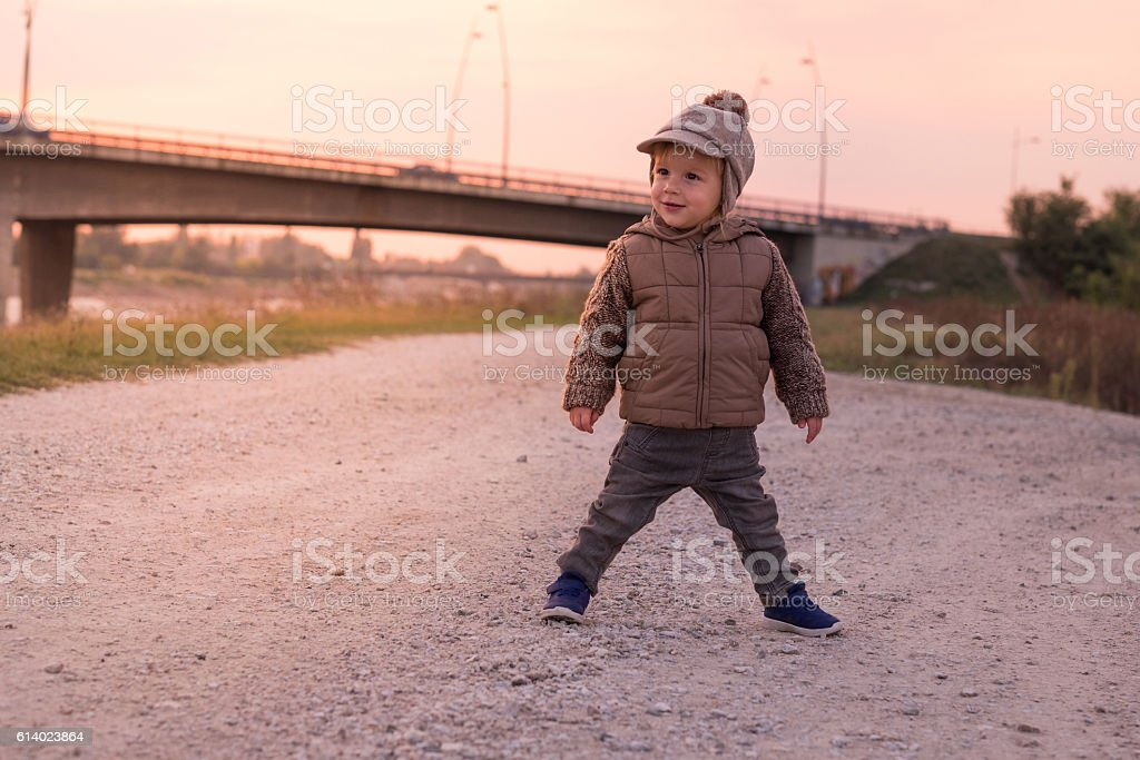 young boy on sunset stock photo