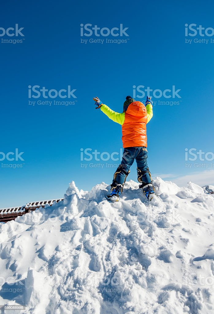 Young boy on top of the mountain stock photo