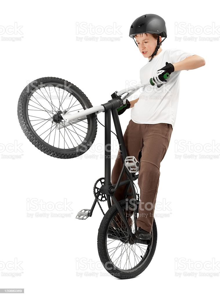 Young boy performing trick on BMX bicycle stock photo