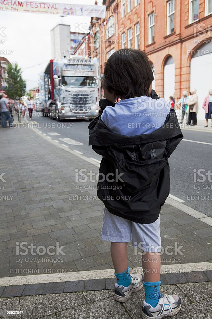 Young boy photographing a parade stock photo